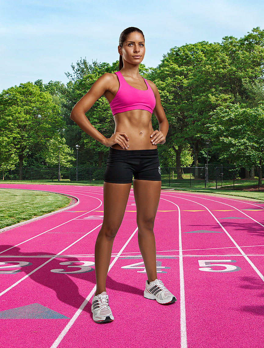 Female runner wearing pink on pink running track